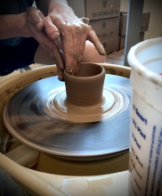 Beginner Pottery Student working